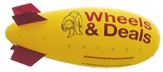 24' giant outdoor advertising blimp, helium filled, great for retail stores, car dealerships, giant advertising blimps can be decorated with 1 color up to full color. decorated advertising blimps. Click here for pics descriptions, prices and to buy 24' outdoor advertising blimps.